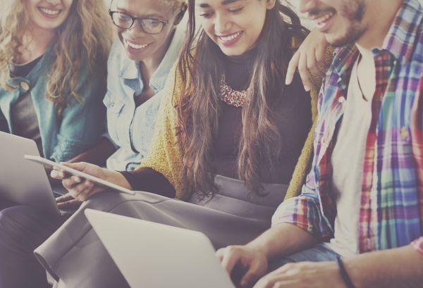 Millennials working together on a Mac