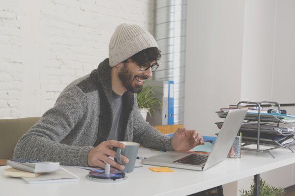 Millennial working on a Mac