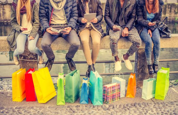 Millennials with colorful gift bags and reading