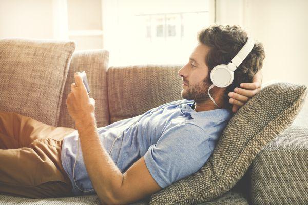 Millennial man streaming a video on phone