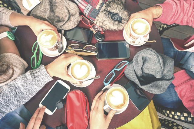 Millennials hanging out at a coffee shop
